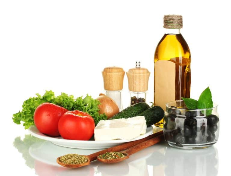 Ingredients for a Greek salad isolated on white background